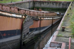 Baquet Les Deux Soeurs, deels gezonken in het dok in Nimy, foto genomen op 30 september 2017