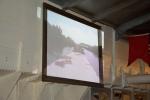 Projectie van een film over het varen tussen Aalter en Beernem met een spits